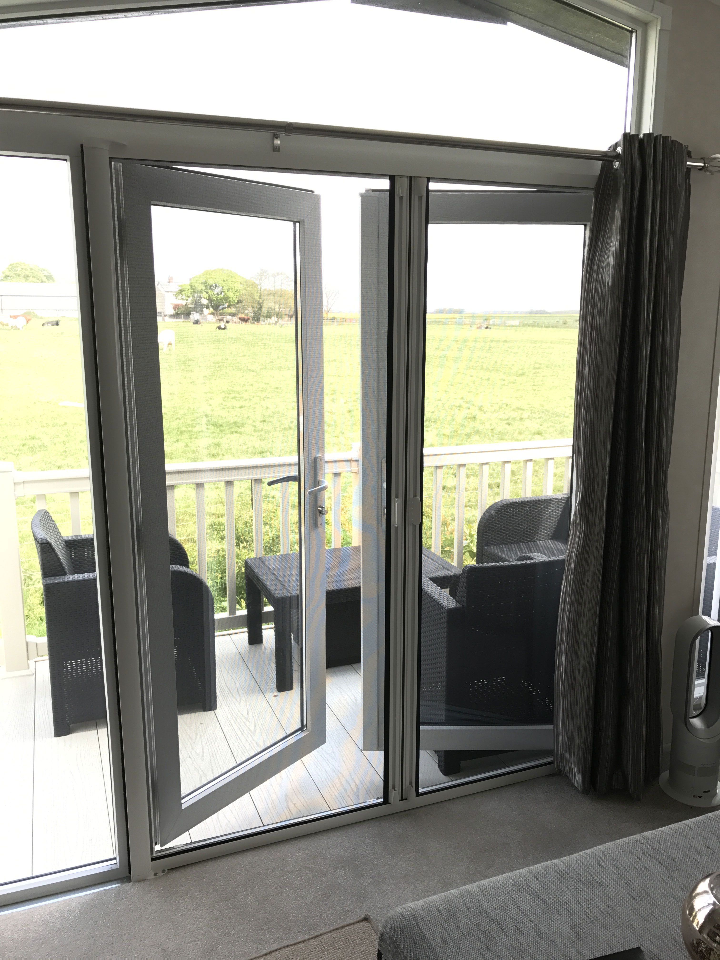 Roller fly screen doors gallery for Roller screens for french doors