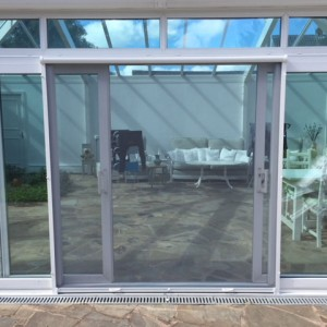 vertical roller fly screen door