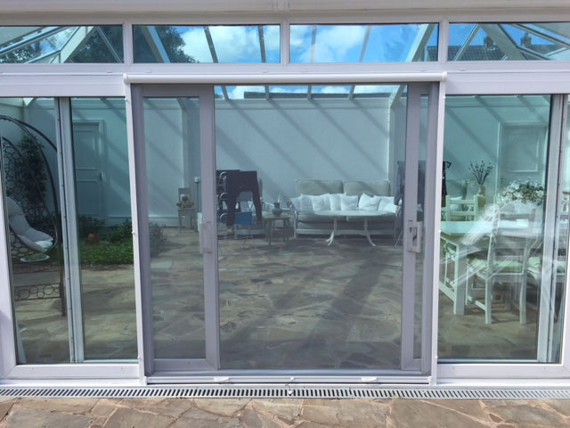 Roller fly screen doors fly protection for all types of for Vertical rolling screen door